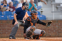 Catcher Dashenko Ricardo #44 of the Bluefield Orioles gives a target as home plate umpire Rich Gonzalez looks on at Howard Johnson Field August 1, 2009 in Johnson City, Tennessee. (Photo by Brian Westerholt / Four Seam Images)