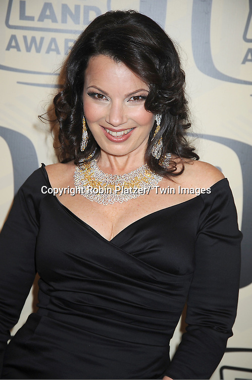 Fran Drescher in Pamela Barrish black dress and Jacob & Co  Jewelry arrives at The 10th Annual TV Land Awards on April 14, 2012 at the Lexington Avenue Armory  in New York City.