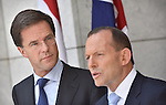 AUSTRALIA, Canberra : The Netherlands Prime Minister Mark Rutte (L) listens during a press conference with Australian Prime Minister Tony Abbott (R) at Parliament House in Canberra on November 6, 2014. AFP PHOTO Mark GRAHAM