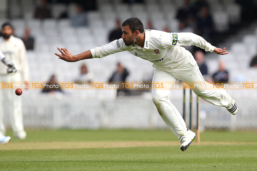 Ravi Bopara of Essex throws the ball and runs out Rory Burns of Surrey - Surrey CCC vs Essex CCC - LV County Championship Division Two Cricket at the Kia Oval, Kennington, London - 22/04/14 - MANDATORY CREDIT: Gavin Ellis/TGSPHOTO - Self billing applies where appropriate - 0845 094 6026 - contact@tgsphoto.co.uk - NO UNPAID USE