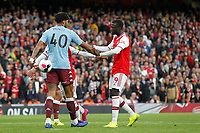 Tyrone Mings of Aston Villa keeps the ball from Nicolas Pépé of Arsenal during the Premier League match between Arsenal and Aston Villa at the Emirates Stadium, London, England on 22 September 2019. Photo by Carlton Myrie / PRiME Media Images.