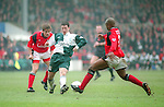Robbie Fowler of Liverpool tackled by Des Little of Nottingham Forest - Premier League - Nottingham Forest v Liverpool - City Ground - Nottingham - England - 23rd March 1996 - Picture Simon Bellis/Sportimage