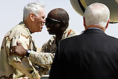 U.S. Navy Adm. Timothy J. Fallon, commander of U.S. Central Command, is greeted by U.S. Marine Maj. Gen. Walter E. Gaskin, commader of the 2nd Battalion, 2nd Marines, upon his arrival at Al Asad Air Base, Iraq, as Secretary of Defense Robert M. Gates looks on, Sept. 3, 2007.  Defense Dept. photo by Cherie A. Thurlby (released)