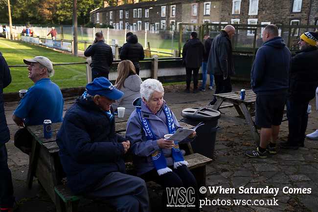 Nelson 3 Daisy Hill 6, 12/10/2019. Victoria Park, North West Counties League, First Division North. Home supporters reading the match programme at half-time as Nelson hosted Daisy Hill at Victoria Park. Founded in 1881, the home club were members of the Football League from 1921-31 and has played at their current ground, known as Little Wembley, since 1971. The visitors won this fixture 6-3, watched by an attendance of 78. Photo by Colin McPherson.