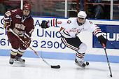 Joe Whitney (BC - 15), Garrett Vermeersch (NU - 9) - The Northeastern University Huskies defeated the Boston College Eagles 3-2 on Friday, February 19, 2010, at Matthews Arena in Boston, Massachusetts.