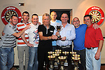 Ollie Thompson Chairperson of the Drogheda and District darts league presents THe Kevin Dunne family cup to Mark Heavy, Neil Barry, Thomas Hynes, Paul McAuley, Damien Geraghty, Niall Courtney and Rocky Andrews of Kellys darts team from Duleek after they won the D&D darts league cup. Photo: Colin Bell/pressphotos.ie
