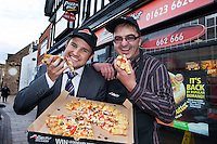 Ryan Bridge from RBS pictured with customer and franchisee owner of Pizza Hut Delivery in Mansfield Lee Humphries
