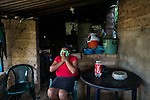 "November 08, 2014. ""Water it´s the real thing""<br /> Raquel lives with her family in Nejapa (El Salvador). Life is so difficult for her because she does'n' t have water at home. The people of Nejapa have no drinking water because the Coca -Cola company overexploited the aquifer in the area, the most important source of water in this Central American country. This means that the population has to walk for hours to get water from wells and rivers. The problem is that these rivers and wells are contaminated by discharges that makes Coca- Cola and other factories that are installed in the area. The problem can increase: Coca Cola company has expansion plans, something that communities and NGOs want to stop. To make a liter of Coca Cola are needed 2,4 liters of water. ©Calamar2/ Pedro ARMESTRE"