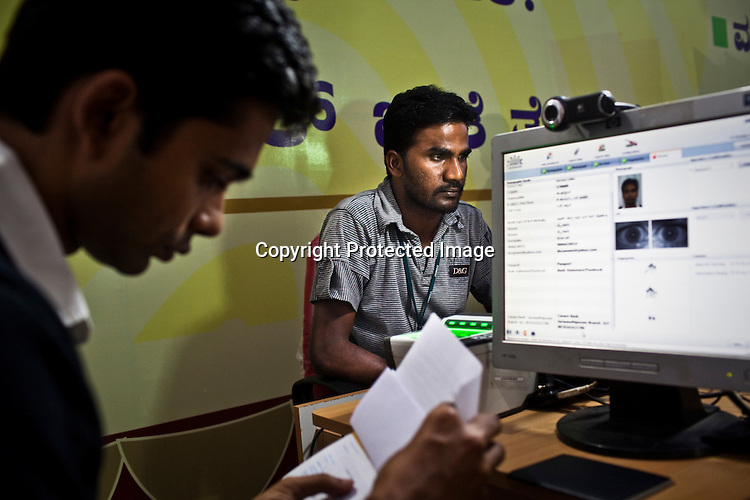 A local resident checks to confirm all data during national identity enrollment in Mysore city in Karnataka, India. Photograph: Sanjit Das/Panos