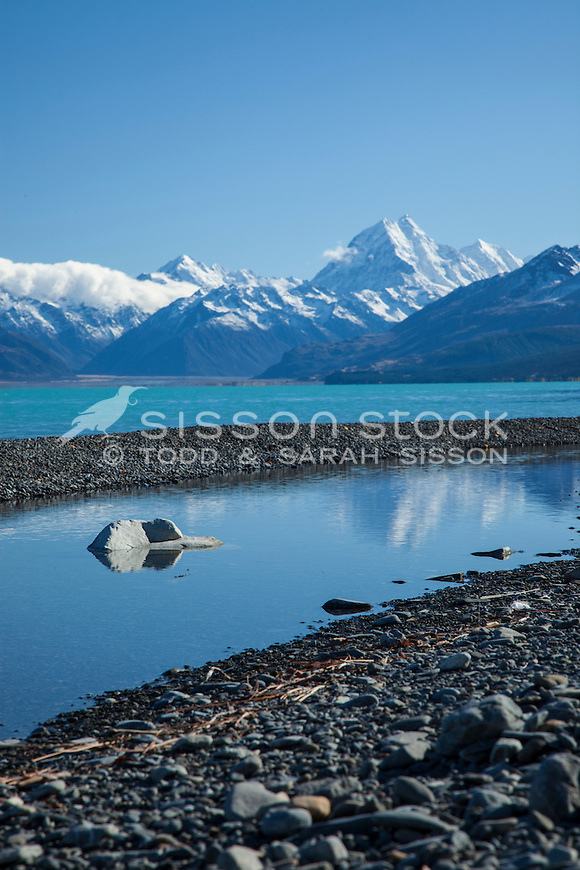 Aoraki Mt Cook and pond on the shore of Lake Pukaki. Mackenzie Country, South Canterbury South Island New Zealand.
