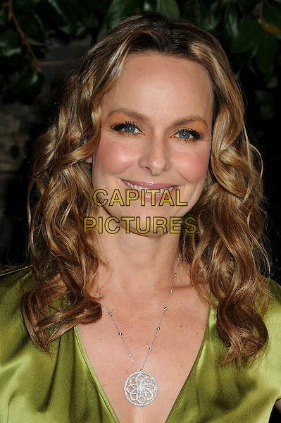 MELORA HARDIN .3rd Annual Women In Film Pre-Oscar Party held at a Private Residence in Beverly Hills, California, USA, .4th March 2010..portrait headshot smiling make-up eyeshadow green silk satin silver necklace .CAP/ADM/BP.©Byron Purvis/AdMedia/Capital Pictures.