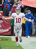New York Giants quarterback Eli Manning (10) acknowledges the cheers of Giants' fans as he comes onto the field prior to the game against the Washington Redskins at FedEx Field in Landover, Maryland on Sunday, November 29, 2015.  The Redskins won the game 20-14.<br /> Credit: Ron Sachs / CNP<br /> (RESTRICTION: NO New York or New Jersey Newspapers or newspapers within a 75 mile radius of New York City)