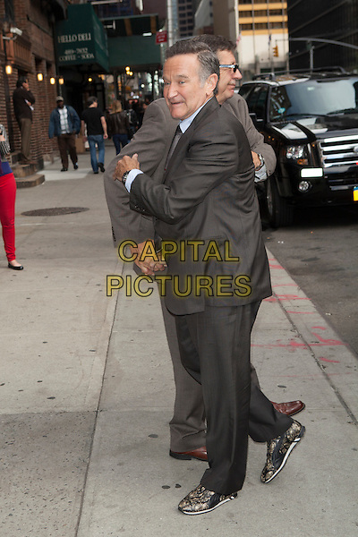 Robin Williams<br /> visits the Late Show With David Letterman, New York City, New York, USA.<br /> September 25th, 2013 <br /> full length grey gray suit side <br /> CAP/MPC/COR<br /> &copy;Corredor99/ MediaPunch/Capital Pictures