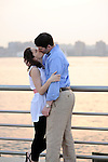 Sunset, engagement photos along a West Side dock on the Hudson River.  (Manhattan, New York City).