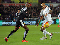 Andre Ayew of Swansea (R)  the Barclays Premier League match between Swansea City and Watford at the Liberty Stadium, Swansea on January 18 2016