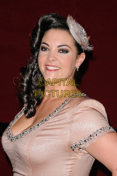 Caro Emerald.World Hunger Day Concert - photocall held at the Royal Albert Hall, London, England..May 28th, 2012.headshot portrait pink feather hair side embellished jewel encrusted trim.CAP/CJ.©Chris Joseph/Capital Pictures.