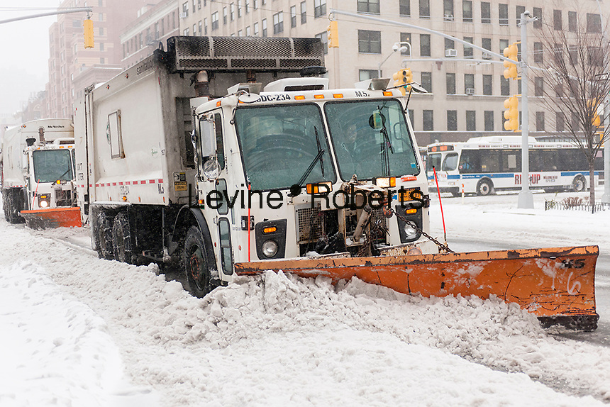 Snow plows in the Chelsea neighborhood of New York on Tuesday, March 14, 2017. Originally predicted as a blizzard with up to 20 inches of snow the storm has changed its course and only 4 to 6 inches of snow, sleet and rain are expected, accompanied by howling winds of course. (© Richard B. Levine)