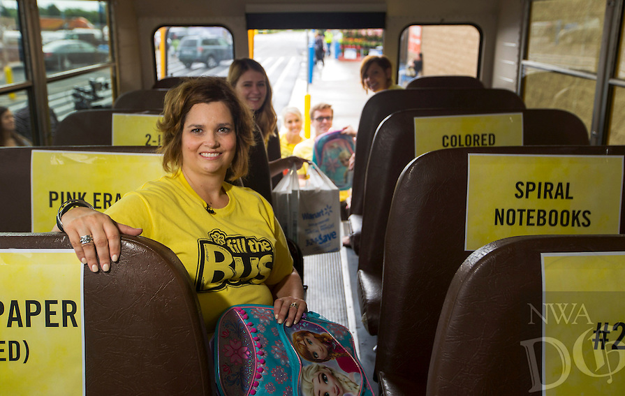 NWA Democrat-Gazette/JASON IVESTER<br /> Christina Hinds, United Way of Northwest Arkansas Vice President of Resource Development; photographed on Tuesday, July 12, 2016, inside a school bus parked outside the Wal-Mart Supercenter in Bentonville for spotlight on Fill the Bus campaign