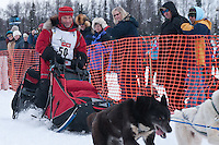 Musher # 50 Rob Loveman at the Restart of the 2009 Iditarod in Willow Alaska