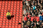Nottingham Forest fans in the Brian Clough Stand shielding their eyes from the sun as they watch the action at the City Ground, Nottingham as Nottingham Forest take on visitors Ipswich Town in an Npower Championship match. Forest won the match by two goals to nil in front of 22,935 spectators.