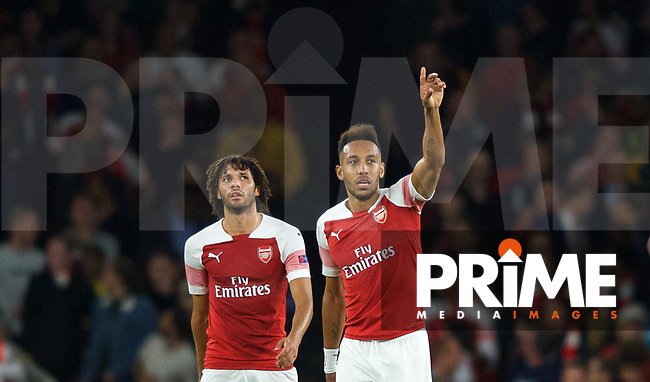 Pierre-Emerick Aubameyang of Arsenal celebrates scoring a goal to make it 1-0 followed by Mohamed Elneny of Arsenal during the UEFA Europa League match group between Arsenal and Vorskla Poltava at the Emirates Stadium, London, England on 20 September 2018. Photo by Andrew Aleksiejczuk / PRiME Media Images.