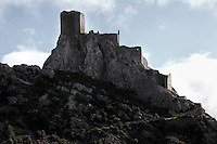"Queribus Castle or Chateau de Queribus, Cathar Castle, Cucugnan, Corbieres, Aude, France. This castle, built from 13th to 16th centuries, is considered the last Cathar stronghold. It sits on a high peak at 728m. It is one of the ""Five Sons of Carcassonne"" or ""Cinq Fils de Carcassonne"". It is a listed monument historique and has been fully restored, restoration work being completed in 2002. Picture by Manuel Cohen"