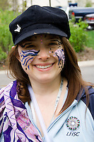 Happy parade participant age 22 with face painted and costumed. MayDay Parade and Festival. Minneapolis Minnesota USA