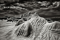 A black and white image of alien sandstone formations in Ah Shi Sle Pah badlands in New Mexico's San Juan Basin.