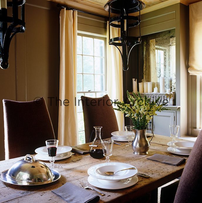 The dining room table looks best when laid for a casual meal with crockery and glassware from La CafetiËre