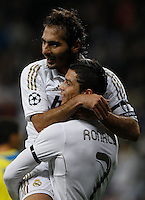 04.03.2012 SPAIN - UEFA Champions League Quarter-Final 2nd  match played between Real Madrid CF vs Apoel FC (5-2) at Santiago Bernabeu stadium. The picture show Hamit Altintop (Turkish/German Midfielder of Real Madrid) and  Cristiano Ronaldo (Portuguese forward of Real Madrid) celebrating his team's goal