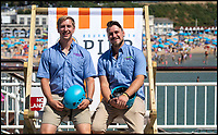 BNPS.co.uk (01202 558833)<br /> Pic: PhilYeomans/BNPS<br /> <br /> Bournemouth zip wire mangers l-r Joe Potter and Chris Stradwick  'Perfect weather this year'<br /> <br /> The summer heatwave is leading to a 'bumper year' for tourism at Britain's premier seaside resort.<br /> <br /> Over 100,000 people are visiting Bournemouth, Dorset, every weekend and hotels are full to capacity, with restaurants packed and huge queues at ice cream stalls.<br /> <br /> Seafront kiosks are selling out of parasols and sun cream, while one bike hire company has reported a 50 per cent increase in business.