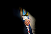 """United States President Donald J. Trump listens to a question while meeting with Klaus Iohannis, Romania's president, in the Oval Office of the White House in Washington, D.C., U.S., on Tuesday, Aug. 20, 2019. Trump said today he's """"not ready to make a deal with China,"""" but adds Beijing wants an agreement and something could happen soon. <br /> Credit: Andrew Harrer / Pool via CNP"""