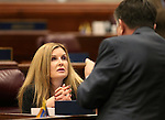 Nevada Assembly Republicans Melissa Woodbury and P.K. O'Neill work on the Assembly floor at the Legislative Building in Carson City, Nev., on Friday, Feb. 13, 2015. <br /> Photo by Cathleen Allison