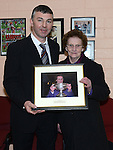 Mrs Rose Everitt who's husband was a founder member of the club is presented with a photo of herself holding the Cardinal O'Donnell cup by club Chairperon Terry Donegan at the 60th birthday celebrations of Mattock Rangers. Photo:Colin Bell/pressphotos.ie