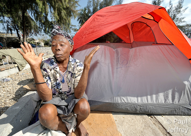 A woman left homeless by Haiti's January 12 earthquake lives in a makeshift tent city in the yard of a partially destroyed church in Port-au-Prince. The quake left hundreds of thousands of people homeless.