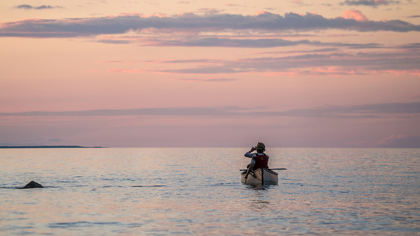 Canoeing at sunset on Lake Superior near Marquette, Michigan.