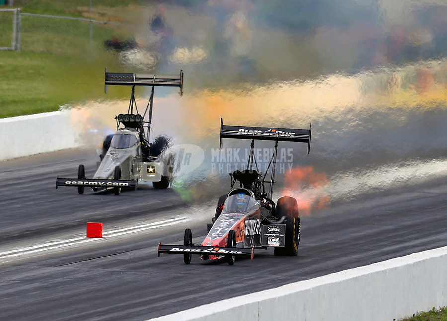 May 21, 2018; Topeka, KS, USA; NHRA top fuel driver Clay Millican (near) defeats Tony Schumacher during the Heartland Nationals at Heartland Motorsports Park. Mandatory Credit: Mark J. Rebilas-USA TODAY Sports