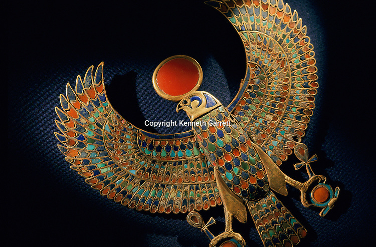 A falcon pendant of the god Re-Horakhti made of gold, carnelian, chalcedony and colored glass paste.