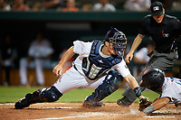 Lakeland Flying Tigers catcher Austin Athmann (19) attempts to tag Tampa Tarpons Francisco Diaz (17) sliding home safely as umpire Sam Burch looks on to make the call during a game on April 5, 2018 at Publix Field at Joker Marchant Stadium in Lakeland, Florida.  Tampa defeated Lakeland 4-2.  (Mike Janes/Four Seam Images)