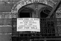 New York, NY - May 1 1987 - Sign on the fire escape of an abandoned tenement reads this is the property of the people of the lower east side.
