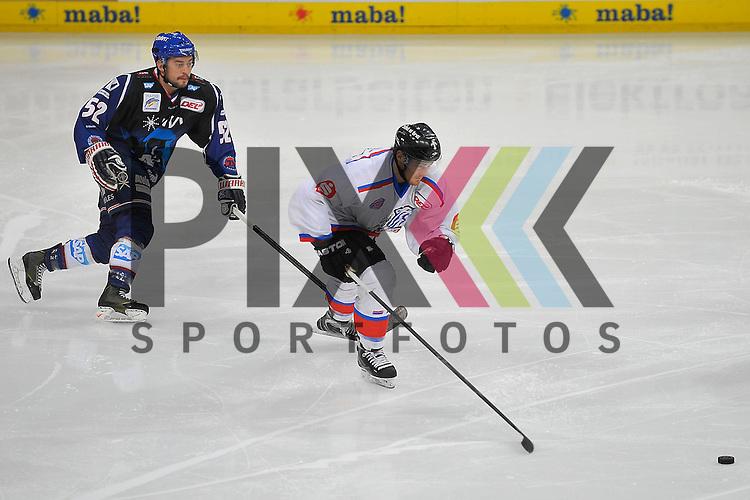 Mannheims Dominik Bittner (Nr.52) gegen Nuernbergs Tim Schuele (Nr.27)  beim Spiel in der DEL, Adler Mannheim - Nuernberg Ice Tigers.<br /> <br /> Foto &copy; Ice-Hockey-Picture-24 *** Foto ist honorarpflichtig! *** Auf Anfrage in hoeherer Qualitaet/Aufloesung. Belegexemplar erbeten. Veroeffentlichung ausschliesslich fuer journalistisch-publizistische Zwecke. For editorial use only.