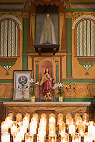 San Juan Bautista, CA<br /> Old Mission San Juan Bautista (1797), interior detail with statue of Jesus and devotional candles