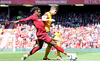 Liverpool's Divock Origi vies for possession with Wolverhampton Wanderers' Matt Doherty<br /> <br /> Photographer Rich Linley/CameraSport<br /> <br /> The Premier League - Liverpool v Wolverhampton Wanderers - Sunday 12th May 2019 - Anfield - Liverpool<br /> <br /> World Copyright © 2019 CameraSport. All rights reserved. 43 Linden Ave. Countesthorpe. Leicester. England. LE8 5PG - Tel: +44 (0) 116 277 4147 - admin@camerasport.com - www.camerasport.com