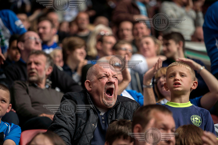 Wigan Football Club fans, in one of the stands, during a match at the club's DW Stadium. /Felix Features