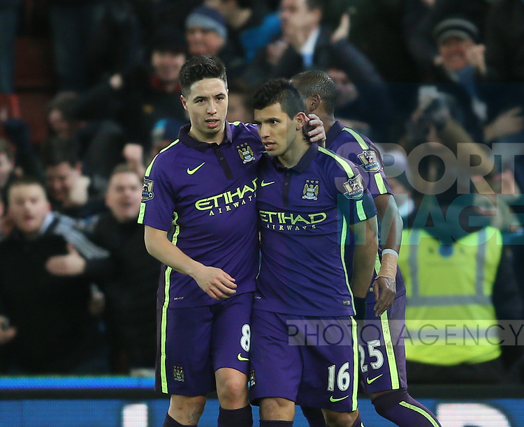 Samir Nasri of Manchester City congratulates with goalscorer Sergio Aguero of Manchester City - Barclays Premier League - Stoke City vs Manchester City - Britannia Stadium - Stoke on Trent - England - 11th February 2015 - Picture Simon Bellis/Sportimage