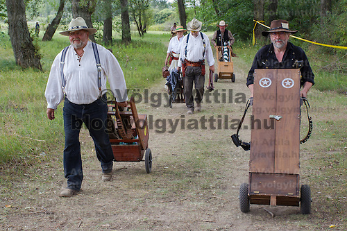 Competitors leave the shooting range after their competition finished during the Cowboy Action Shooting European Championship in Dabas, Hungary on August 11, 2012. ATTILA VOLGYI
