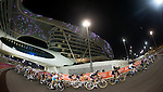 The peloton in action under floodlights during Stage 4, The Yas Stage, of the 2015 Abu Dhabi Tour running 110 km 20 laps around the Yas Marina Circuit, Abu Dhabi. 11th October 2015.<br /> Picture: ANSA/Claudio Peri | Newsfile