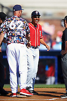 New Hampshire Fisher Cats manager Bobby Meacham (10) shakes hands with Dusty Wathan (62) during the lineup exchange before a game against the Reading Fightin Phils on June 6, 2016 at FirstEnergy Stadium in Reading, Pennsylvania.  Reading defeated New Hampshire 2-1.  (Mike Janes/Four Seam Images)