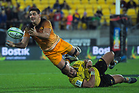 Jaguares' Pablo Matera is tackled by Asofa Aumua during the Super Rugby match between the Hurricanes and Jaguares at Westpac Stadium in Wellington, New Zealand on Friday, 17 May 2019. Photo: Dave Lintott / lintottphoto.co.nz