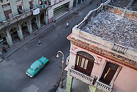 Vintage car driving through the streets of Havana, Cuba.